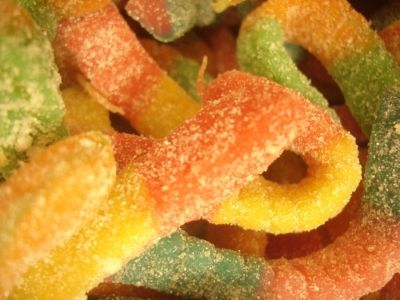 Sugar coated gummy worms by Jason Meredith.
