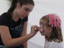 Face Painter At The Sunday Market