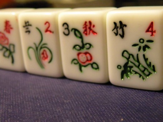 Flowers/Season: There are four Flower tiles and four Season tiles. They are optional to play with. They are most often used in gambling for points.