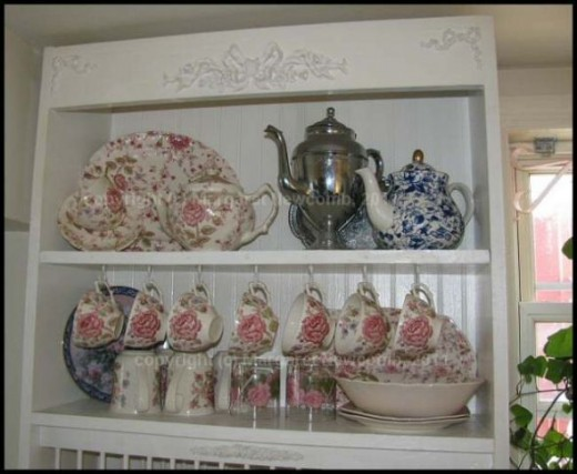 This is a view of the top two shelves of the plate rack cabinet.  I use these shelves for cups and display.