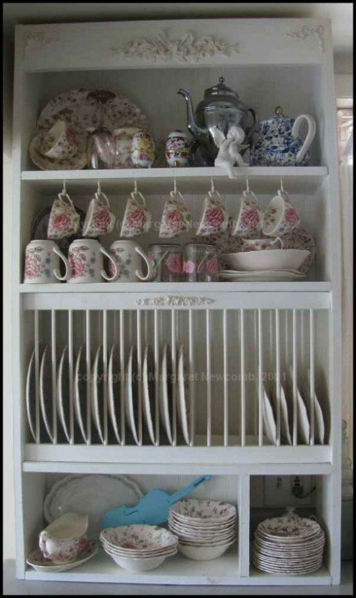 My finished plate rack cabinet.  Mine is filled mostly with Johnson Brothers china in the chintz rose pattern.