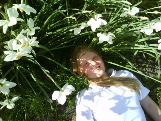 My Daughter Just laying in the field