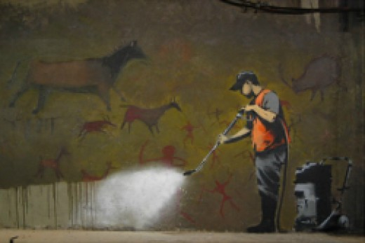 Banksy cleaning cave graffiti