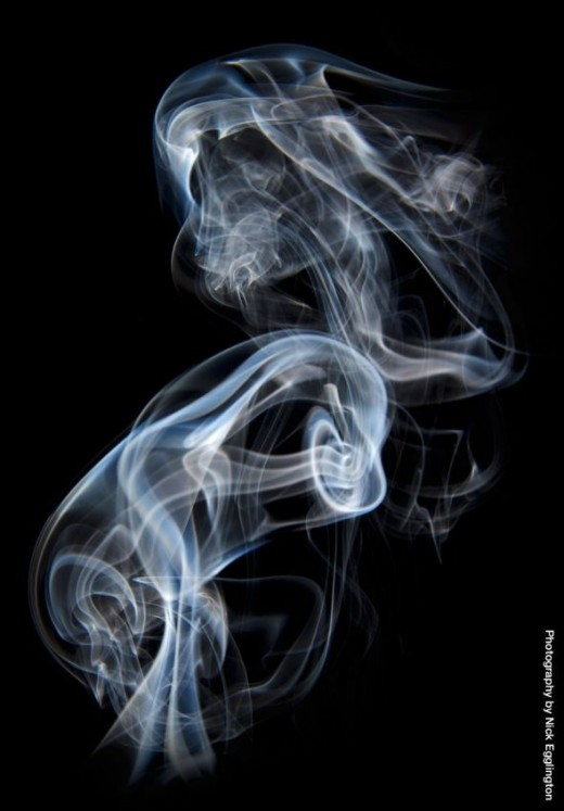 A ghostly smoke warrior appears in the dark.