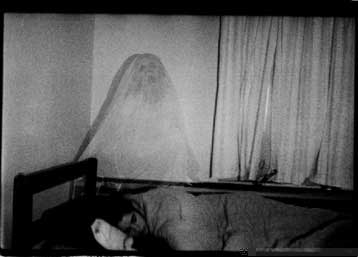 """He doesn't realize there is a """"ghost"""" behind him."""