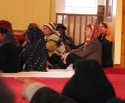 Jules Corriere and Bliss Brown at a Sikh service in Edinburgh