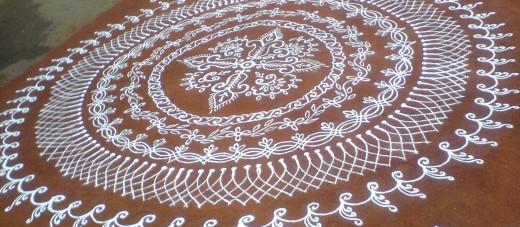 rangoli with white stone powder