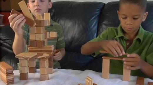 Kids engrossed with Tegu Blocks