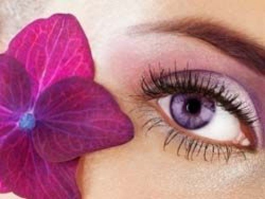Girl wearing violet colored contacts
