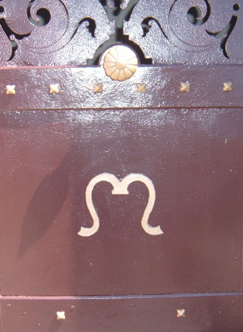 "Stylised Omega symbol on the metalwork. The Omega is the last letter of the Greek alphabet and signifies ""the end."""