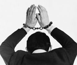 A Handcuffed Man Raises His Hands Above His Head  - Buy on Allposters