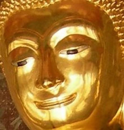 Smiling Buddha at Wat Suthat by Nick Upton