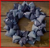 http://www.artfire.com/ext/shop/product_view/sooboo/2877392/blue_jean_denim_fabric_wreath/handmade/housewares/home_decor/wreath