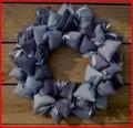 http://www.artfire.com/ext/shop/product_view/sooboo/2877392/blue_jean_denim_fabric_wreath/handmade/housewares/home_decor/wreath