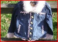 http://www.etsy.com/listing/64347978/re-tread-decorated-girls-jean-jacket
