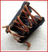 http://www.etsy.com/listing/92563395/laced-denim-cuff