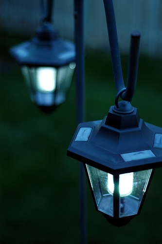 Solar-powered lanterns on a terrace, outdoors. Copyright Ian Muttoo @ Flickr