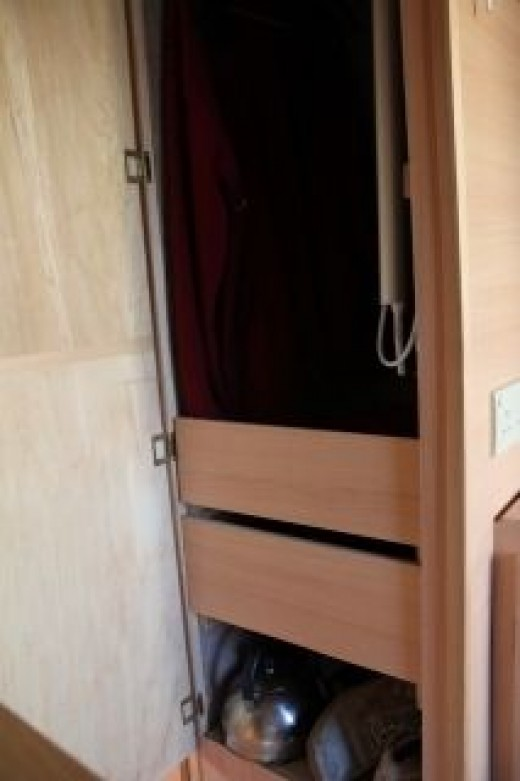 the drawers in the wardrobe have proved to be very good and can be removed easily to get to the leisure battery and the fresh water tank