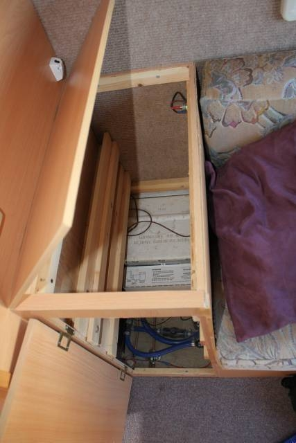 Cupboard with all drawers  and tray removed give access to the Propex water heater