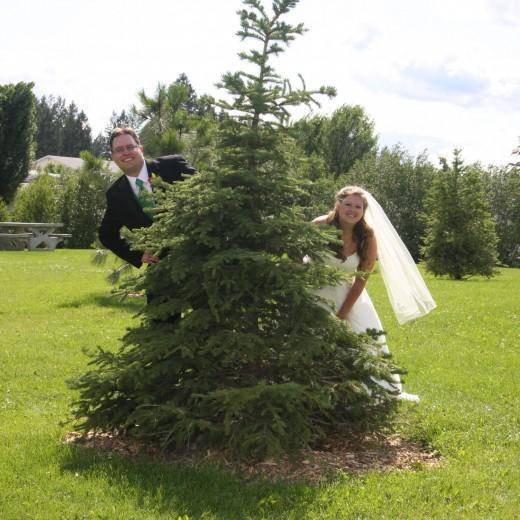 Bride and groom posing for wedding photos.