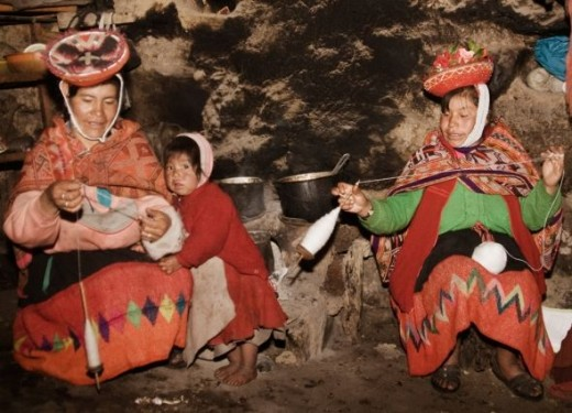 women spin in their home - Chaullacocha village. Click to see video