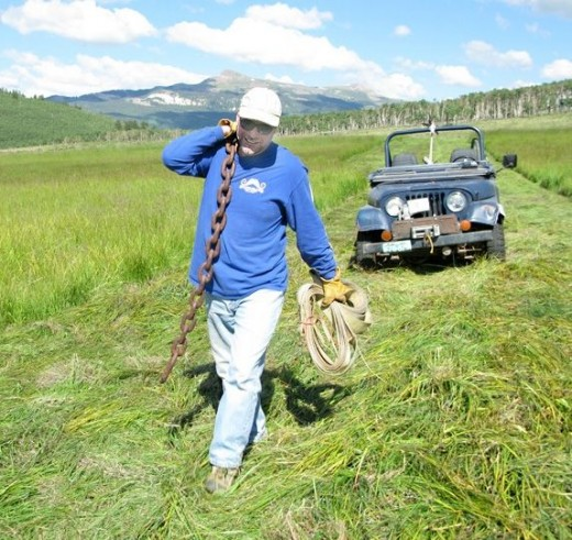 Jim works the hay fields in Lake City Colorado.