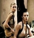 Two women, one with exposed midriff, the other with a dress that looks similar to Gorgo's 'Farewell' dress