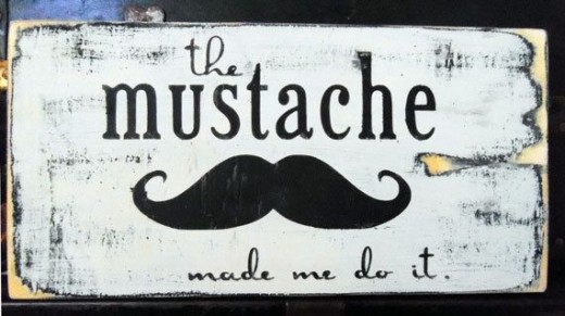 This mustache sign can be purchased at http://www.etsy.com/listing/93829616/typography-wood-sign-the-mustache-made