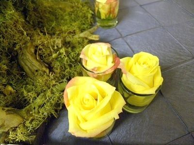 yellow rose with votive table decoration