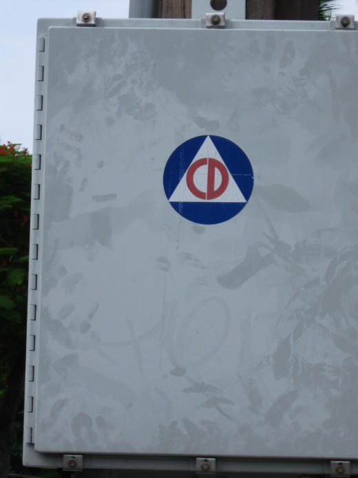 Civil Defense call box along road.  During the Cold War the CD symbol was common everywhere as CD teams were first responders in event of a Soviet nuclear attack.  Today the CD symbol is still seen in Hawaii but the threat is from Mother Nature rathe