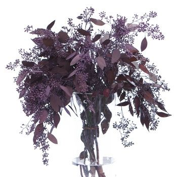 I love the texture of seeded eucalyptus - it also has a pleasant scent. Ive seen tables decorated with vases of this, surrounded by votive candles. It's easy to do, looks great and doesn't cost much either. From Fifty Flowers.