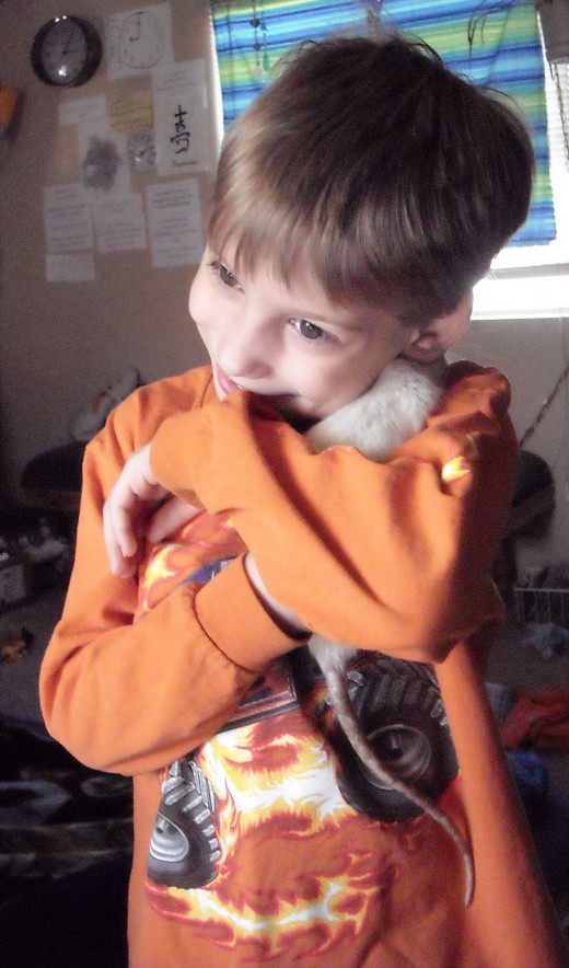 My little brother with his rat Starlight!