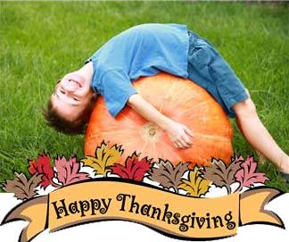 Thanksgiving photo of boy lying across a pumpkin