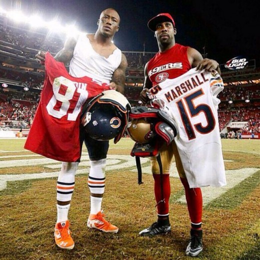 Brandon Marshall and Anquan Boldin trading jerseys after epic SNF game.