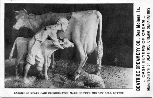 John K. Daniels' butter cow at the 1911 Iowa State Fair. Postcard of John K. Daniels's butter sculpture of a boy, cow, and calf, Iowa State Fair, 1904. Sponsored by Beatrice Creamery Co.