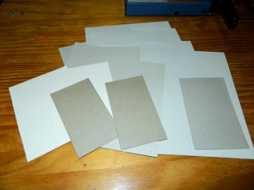 The blank side of some of our cardboard pages.