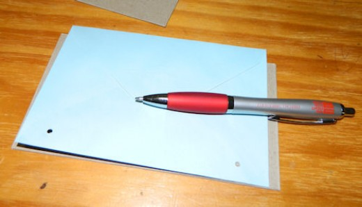 Use the page you punched first as a template to mark where the holes need to go on the other pages.
