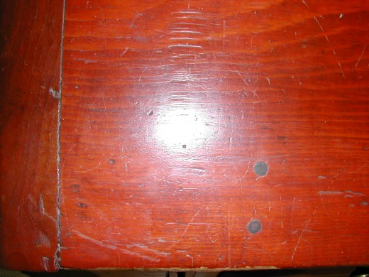 Detail on left side of slant top, showing wooden pegs.