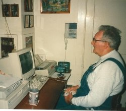 My Dad Clyde Martin working/playing at his computer station on the cherry slant-top desk. Clyde was the great-grandson of David Greacen Kennedy.