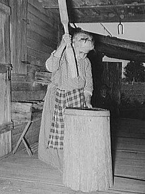 Cajun Woman Hulling Rice in 1938