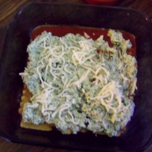 Add cheese mix, spinach (if you haven't mixed it in the cheese already) Add sauce, sprinkle shredded cheese on top.