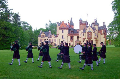 Northern Constabulary Pipe Band performing on the lawns of Aldourie Castle.
