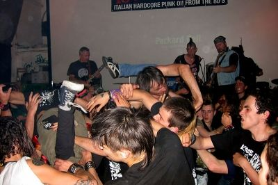 Pogo and Stage Diving in the Mosh Pit