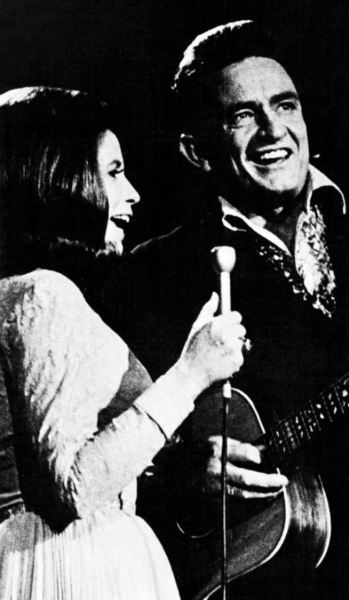 Johnny and June Cash performing