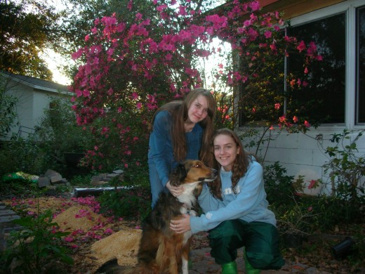 Kelsey & Kiersten and our dog (Callie) in our backyard...
