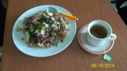 A Plate Of Potato Fries With Fruit And Veggies Goes With Green Tea