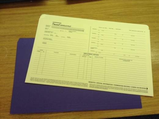 You can use a personnel envelope file or a legal sized file to house your various folders.