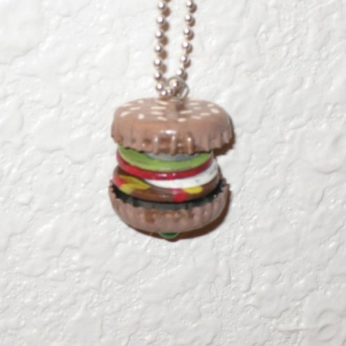 Hamburger pendant made with bottle caps, washers, nuts, acrylic paint, and headpin. Photo Credit:  Peggy Hazelwood.