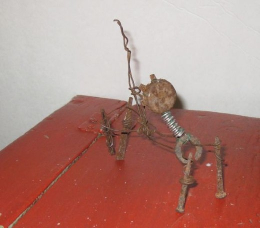 Wire cat made with found objects.