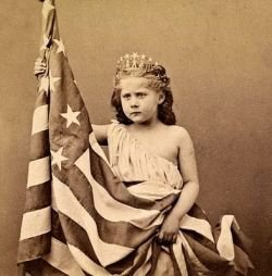 Vintage photograph of girl with flag. Courtesy The Graphics Fairy.